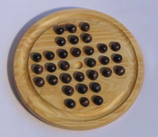 Simple wood version of English peg solitaire with start position.